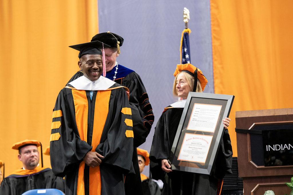 2018 Commencement keynote speaker Rev. Charles Harrison receiving his honorary degree