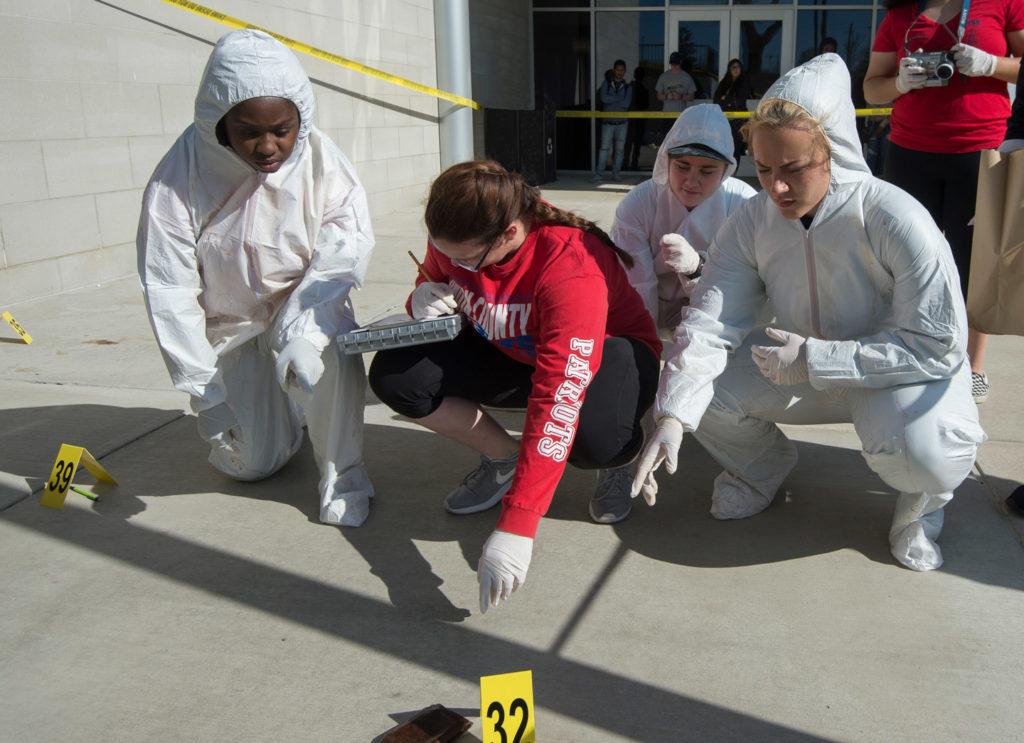 Students working a mock crime scene