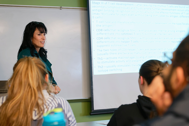 Amy Shank, Assistant Professor of Biology, presenting a lecture to students