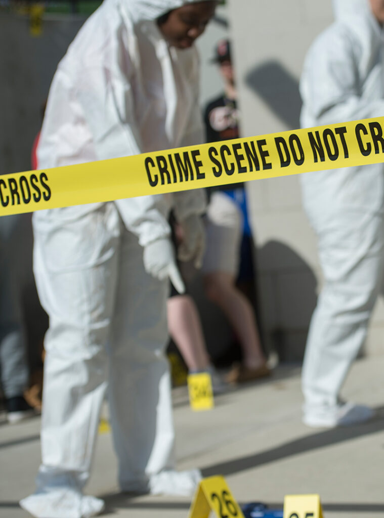 Students participating in a crime scene project