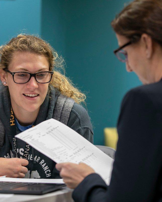 Nicole Scott, Ed.D., Associate Vice President of Student Success, assisting a student