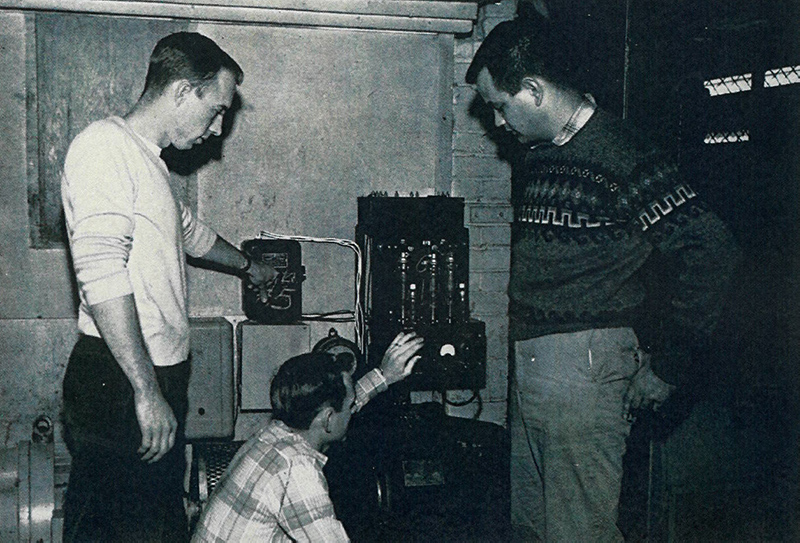 Richard D. Dermer and students testing a voltage regulator for a motor generator