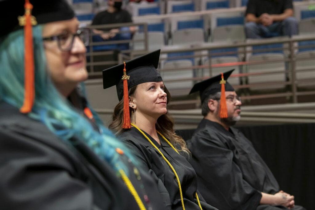 Trisha sitting with other Indiana Tech graduates